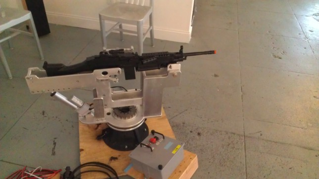 A dummy rifle representing the SAW M249 in the hydraulic, software controlled aiming mount we had custom built.